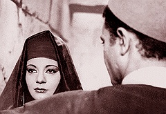 A shot from the movie in black and white, yet the version screened at the AUC was in colors, so you can see the make-up lines of Egyptian actress, Nadia Lotfi.